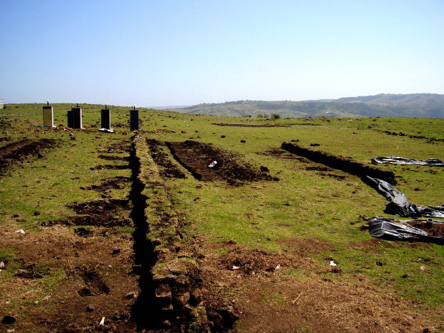 Terrace walls topped with grass and swales beneath