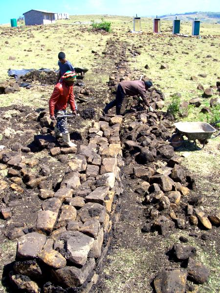 Terraces being built with rocks