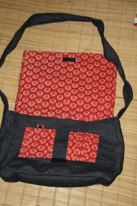 They include lining, padded arm strap, cell phone pouch and pen holders!