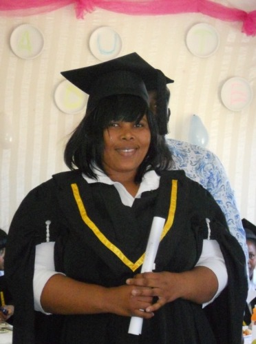 Nomzingisi, head of the BI care workers, happily receives her diploma