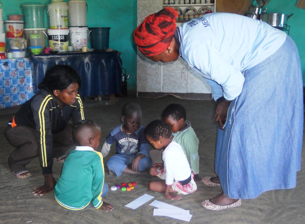 Mentor Mothers do Early Childhood Development with the children by asking them to sort colors and draw pictures.