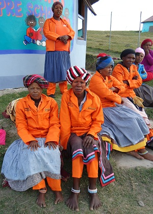 Workers from the Community Workers' Programme (CWP) benefit the villages by mending roads, removing alien vegetation, growing food gardens, working in the preschools and the Skills Development Centre. Here their new uniforms are mixed with traditional styling.